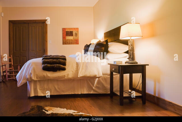 guest bedroom brown white animal hide skin rug king size bed in basement inside a luxurious
