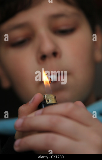 A boy lighting a cigarette.  sc 1 st  Alamy & Boy Lighting Cigarette Stock Photos u0026 Boy Lighting Cigarette Stock ... azcodes.com
