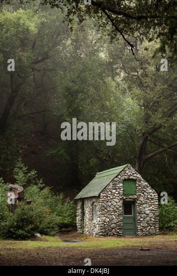 Woods forest cabin house secluded stock photos woods for Small stone cabin