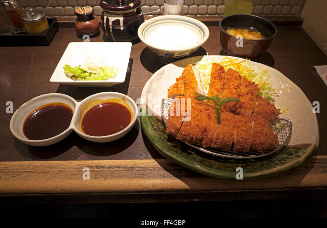 serving of miso katsu (pork cutlet with miso sauce) at Yabaton ...