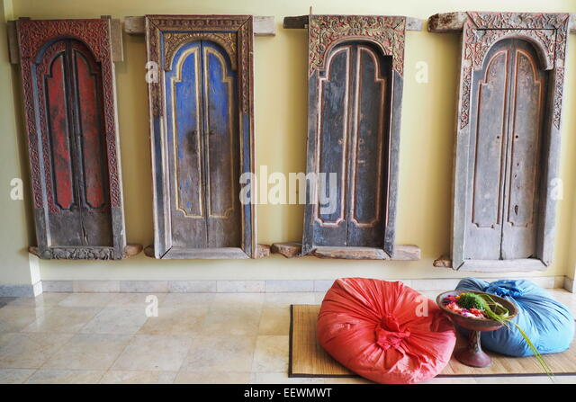 Four antique traditional Bali doors hanging on a wall. - Stock Image : balinese doors - Pezcame.Com