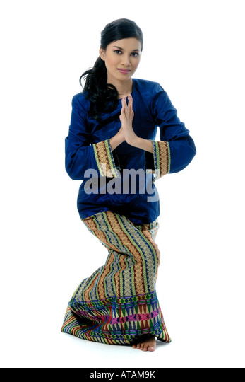Malaysian girl dancer with wear modern kurung and batik stock image