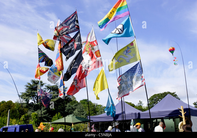 a collection of decorative flags for sale at an open air market in north wales - Decorative Flags