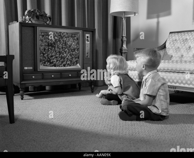 black kids watching tv. 1960s two children boy \u0026 girl sitting on floor watching television - stock image black kids watching tv e