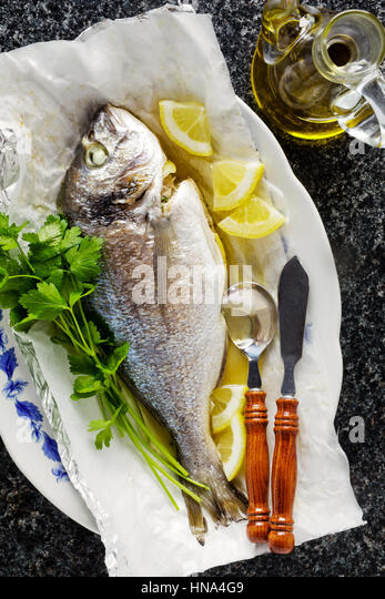 Battered fish on plate isolated stock photos battered for Frying fish in olive oil