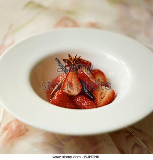 Marinated strawberries with star anise, cinnamon & vanilla - Stock ...