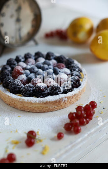 Gluten-free berry tart and sprig of redberries - Stock Image