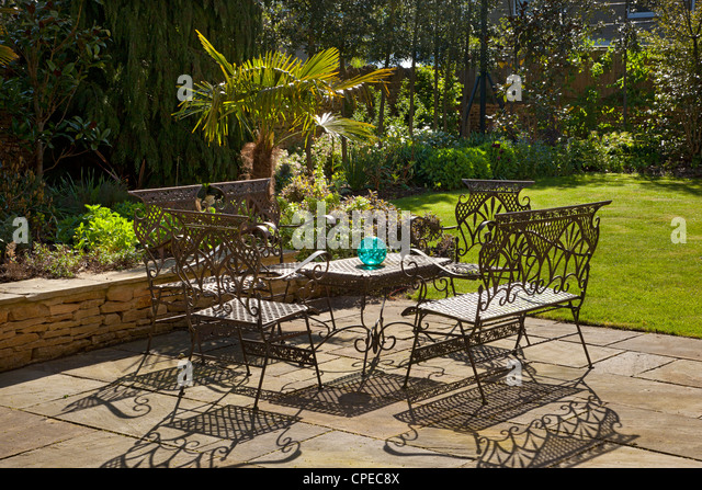 Superb French Style Metal Table And Chairs Furniture On Stone Patio In Summer  Garden   Stock Image