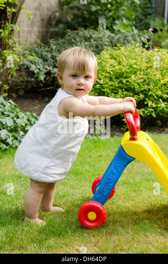 Toys For Toddlers Learning To Walk : Baby walker stock photos images alamy