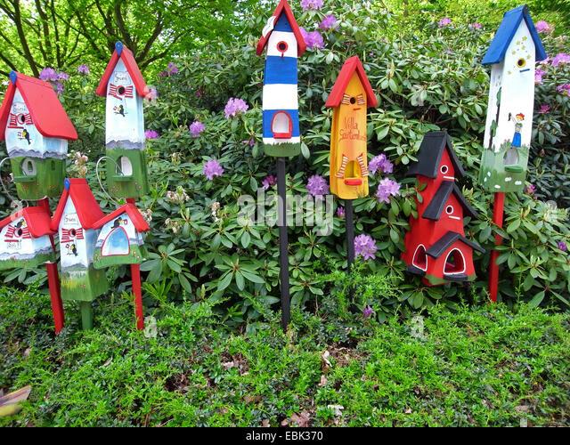 Colourful Bird Houses In A Garden   Stock Image