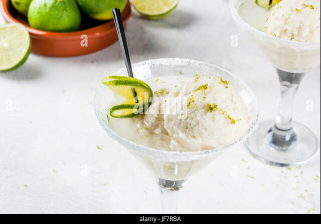 Refreshing summer alcoholic cocktail floating margarita. With tonic and salted lime ice cream with zest. With a - Stock Image