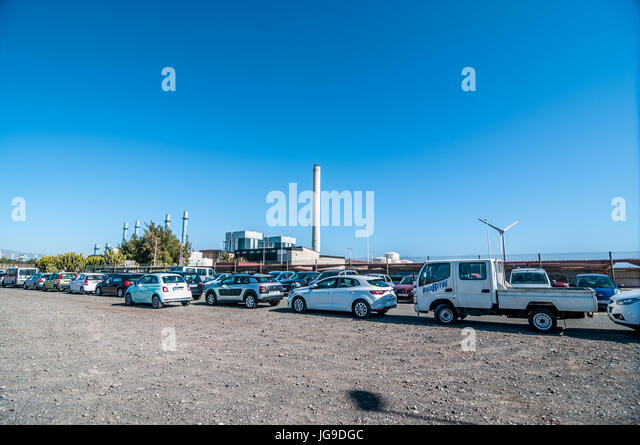 Car parking of thermal power plant of Barranco de Tirajana in Gran Canaria, Canary Islands, Spain - Stock Image