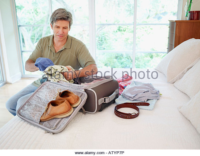 Person with suitcase house stock photos person with suitcase house stock images alamy - Man bedroom photo ...