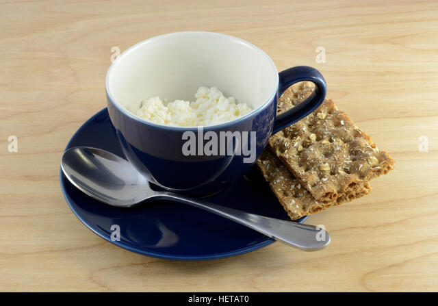 Don't Say Cheese Cottage-cheese-in-cup-ans-crispbread-on-saucer-with-spoon-hetat0