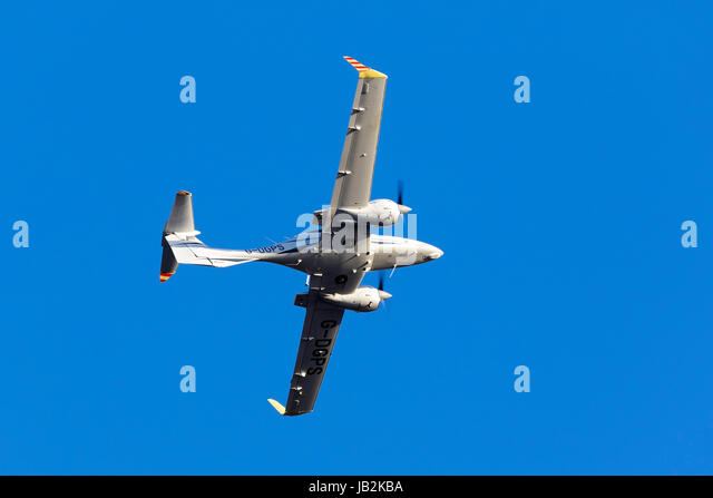 Diamond DA-42 MPP Guardian [G-DGPS] performing a missed approach on runway 31. - Stock Image