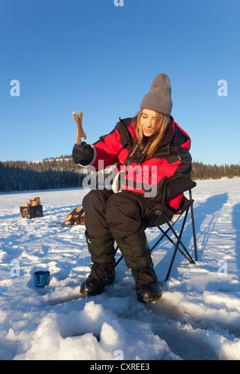 Ice fishing woman female stock photos ice fishing woman for Ice fishing canada