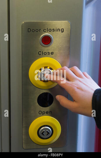 A woman pressing a close door button on a CrossCountry train in England - Stock Image & Train Door Button Stock Photos \u0026 Train Door Button Stock Images ... Pezcame.Com