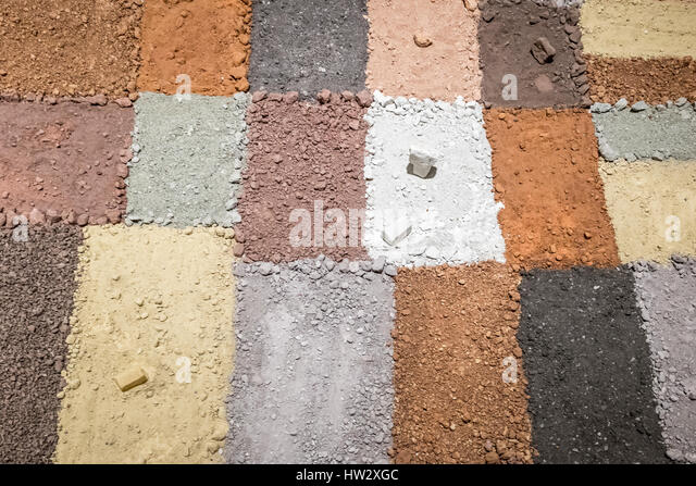 Black mud ground texture background stock photos black mud texture of different colors of dry clay with stones stock image sciox Images