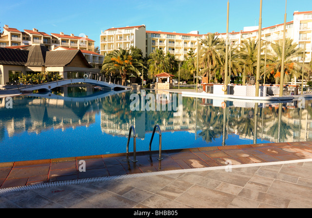 Swimming Pool And Bridge Of Hotel In Side Stock Photos