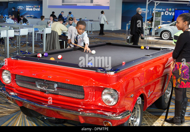 Children Play On A Pool Table Made To Look Like A Ford Mustang   Stock Image