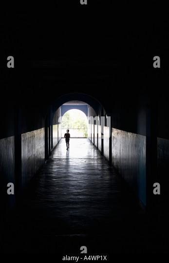 Child Walking Through A Dark Hallway   Stock Image