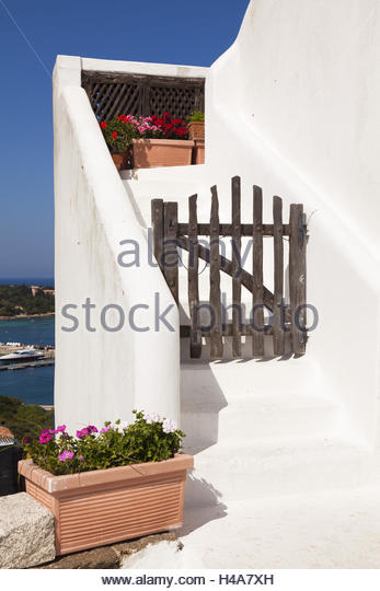 Wooden Gate Before Stairs Of A White Whitewashed House, Italy, Sardinia,