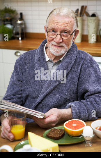 elderly man eating dinner stock photos elderly man eating dinner stock images alamy. Black Bedroom Furniture Sets. Home Design Ideas