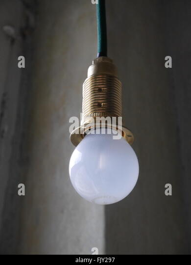 Ceiling light bulb hanging on stock photos ceiling light bulb low angle view of white light bulb hanging from ceiling stock image aloadofball Choice Image