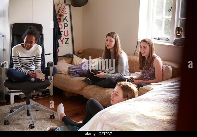 Girls Playing Video Game In Stock Photos Girls Playing Video
