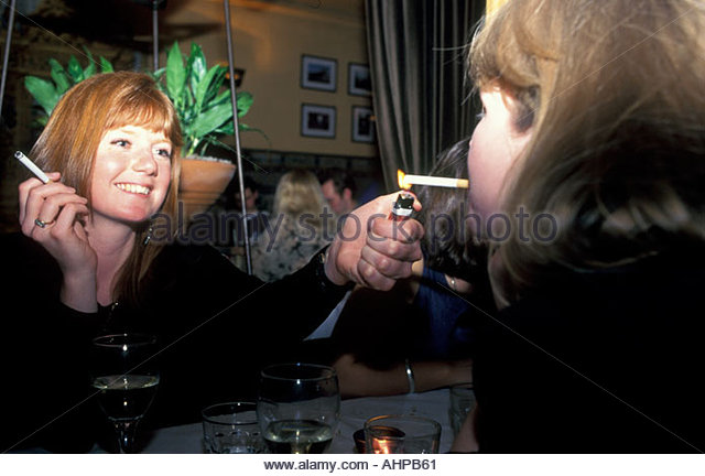 http://l7.alamy.com/zooms/265b70581fdb4126b374f7c4bc047c5c/young-women-smoking-and-drinking-in-restaurant-uk-ahpb61.jpg