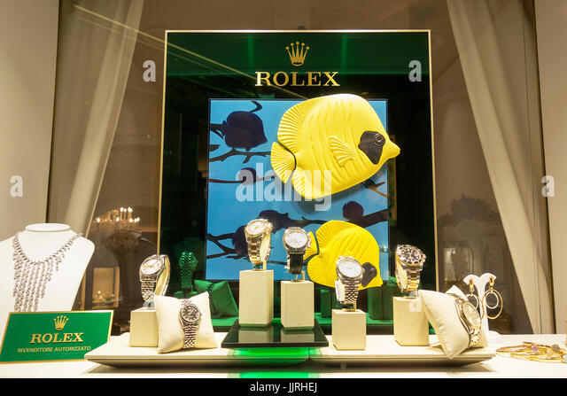 Rolex watches on display in a shop window - Stock Image