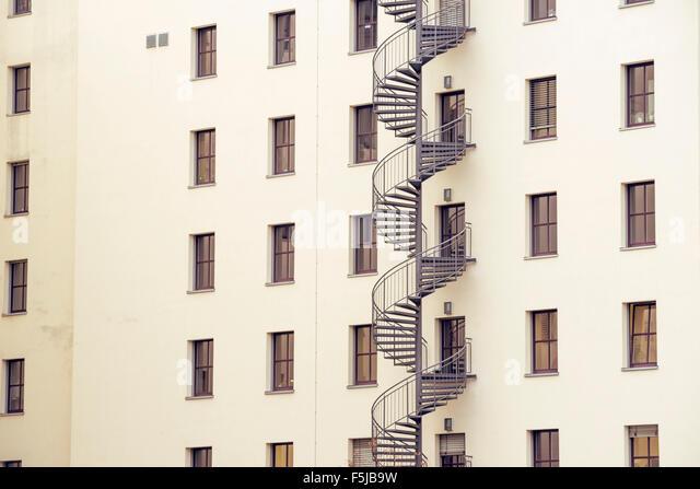 Apartment Building Fire Escape Ladder fire escape ladder window stock photos & fire escape ladder window