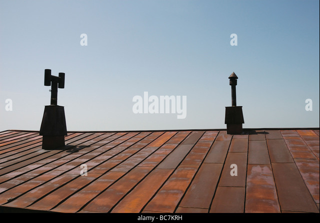 Rusty Metal Roof Off Mountain Hut With 2 Chimneys And Blue Sky   Stock Image