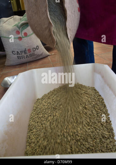 Thomas Hansen shakes a bag with green coffee bean into a vat for roasting  at the. Bean Bag Business Stock Photos   Bean Bag Business Stock Images