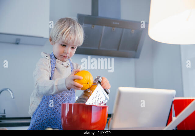 Little Boy Standing In Kitchen Stock Photos & Little Boy Standing ...
