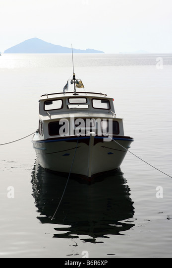 Motor boat sunset stock photos motor boat sunset stock for Small fishing boats with motor