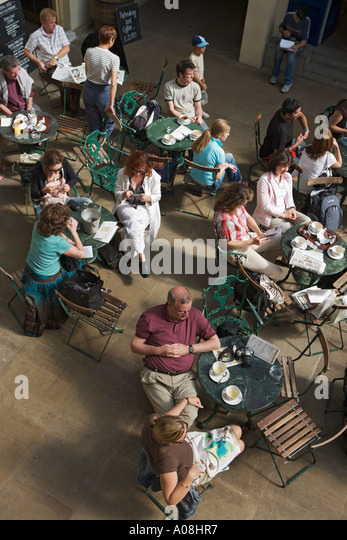 Shoppers Relaxing At A Cafe In Covent Garden London UK