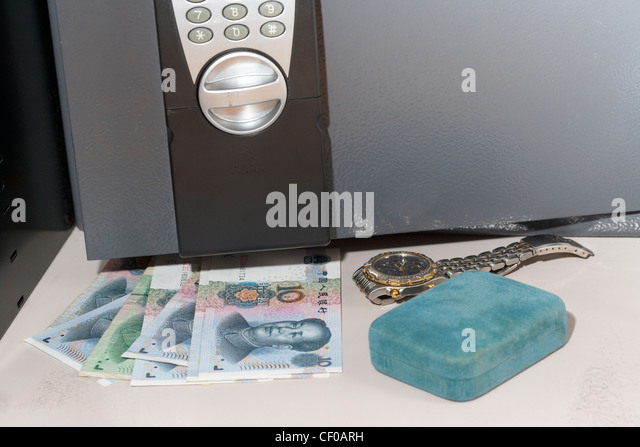 hiding chinese renminbi cash and other valuables in a small home safe stock image