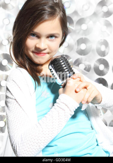 Child Teen Girl Singing Microphone Stock Photos & Child