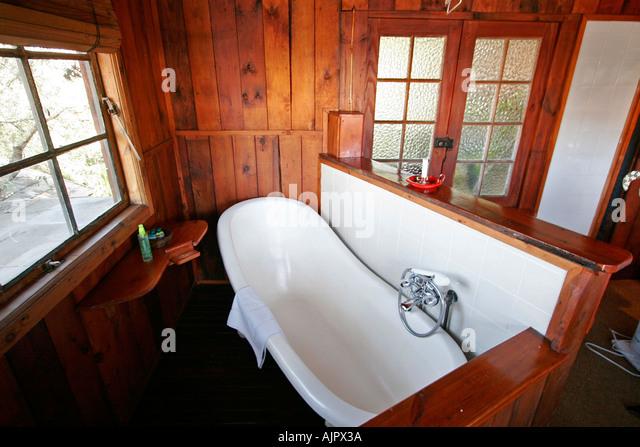 Bath tube stock photos bath tube stock images alamy for Backyard guest house with bathroom