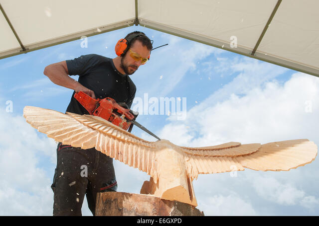 Chainsaw carving carver wood stock photos
