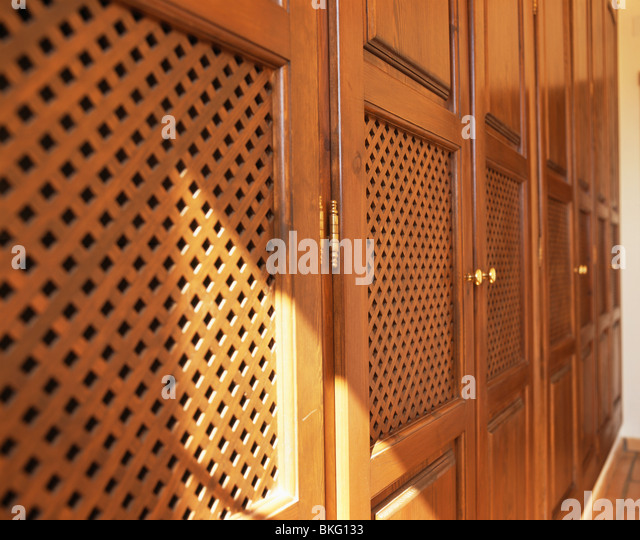 Close-up of bedroom storage unit with fretwork doors - Stock Image & Fretwork Doors Stock Photos \u0026 Fretwork Doors Stock Images - Alamy