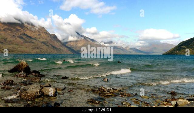 Mount earnslaw new zealand stock photos mount earnslaw for L shaped lake