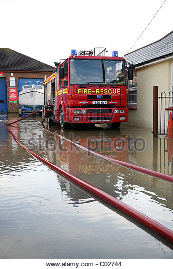 Fire Engines In A Flooded Yard   Stock Image