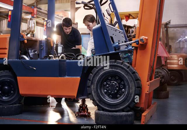 Mechanics Workshop Stock Photos  Mechanics Workshop Stock Images - Forklift mechanic