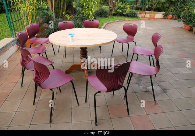 Plastic Chairs And Table Stock Photos amp Plastic Chairs And  : plastic chairs kept around wooden table with mug 18 january 2009 et1jgh from www.alamy.com size 640 x 445 jpeg 105kB