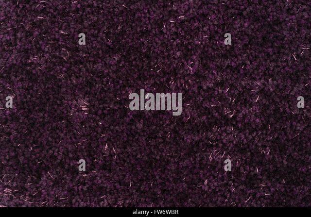 purple carpet texture. closeup detail of purple carpet texture background. - stock image