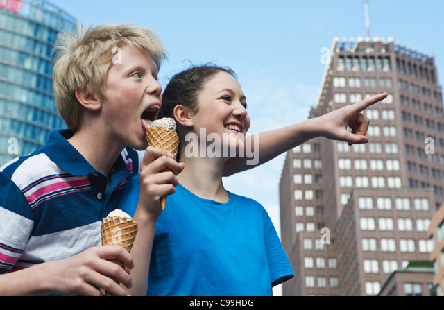 http://l7.alamy.com/zooms/2905a9c8bebc46d5867aa38cbf2c1cf1/germany-berlin-teenage-couple-eating-ice-cream-c99hdg.jpg