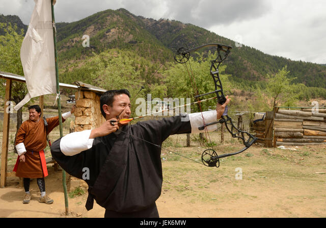 Man practicing national sport of archery, Thimphu, Bhutan, asia - Stock Image