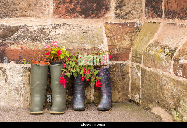 Pairs Of Wellingtons Used As Unusual Plant Pot Containers Outside Old  Church, St Maryu0027s Church
